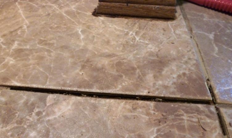 bathroom tile repair removing old grout